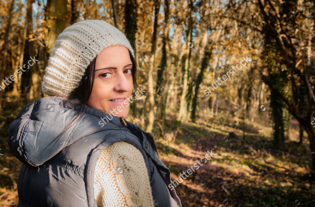 stock-photo-happy-woman-walking-through-woodland-in-autumn-620452727